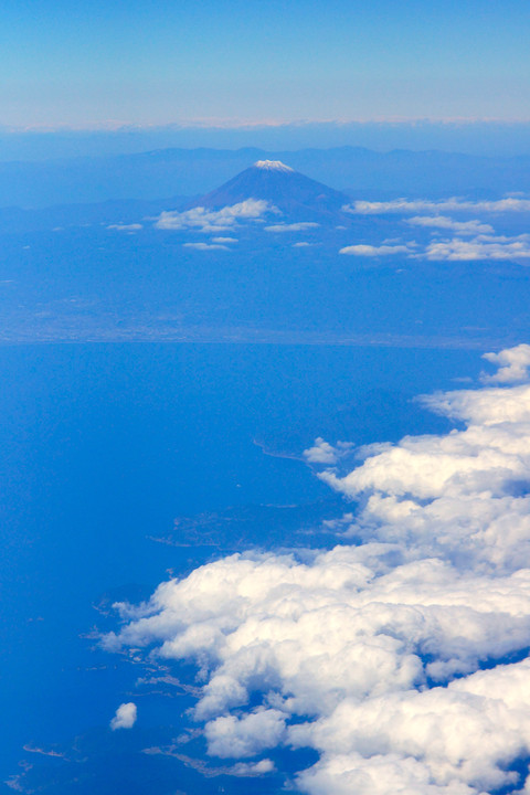 From the window of the airplane , Mt. Fuji