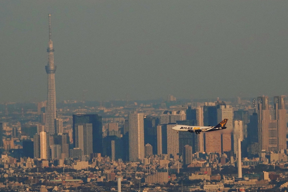 Air cargo flying over Tokyo